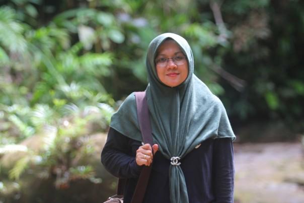 Dr.Afni Zulkifli,M.Si