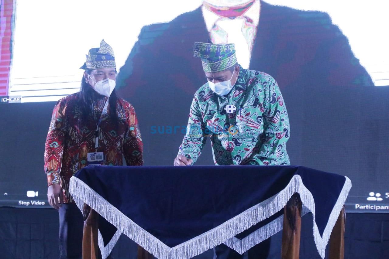 Ketua Presidum JKPI H. Alfedri menandatangani MoU kerjasama JKPI dengan ICHCAP