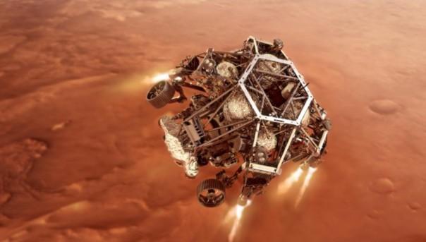 Pesawat penjelajah Perseverance NASA menyalakan mesin tahap turunnya saat mendekati permukaan Mars dalam ilustrasi ini. (FOTO: NASA )
