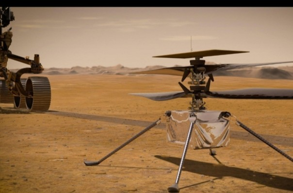 Dalam ilustrasi ini, Helikopter Mars Ingenuity NASA berdiri di permukaan Planet Merah saat penjelajah Perseverance NASA (sebagian terlihat di kiri) berguling.(Sumber Foto :  NASA / JPL-Caltech)